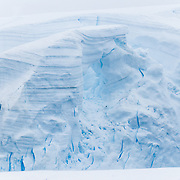 Glacier ice forms an arch on an Antarctic Island.