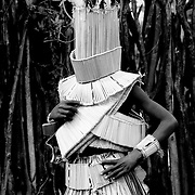 A Vhawhera male inititiate poses in his reed mask inside the stockade of haModjadji, in the palace of the late Rain Queen Modjajdi IV. 1990, Greg Marinovich.