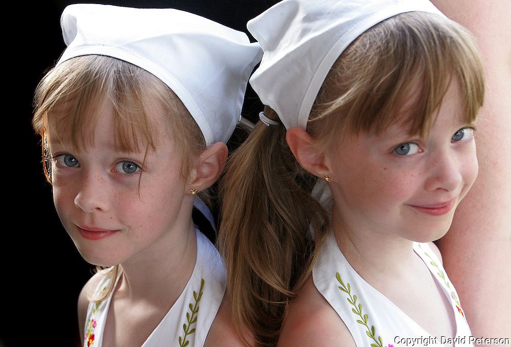 Isabelle, left, and Rayanne Dally, 6-year-old identical twins from Des Moines, wait for their category to be called during the Twins, Triplets and More Contest at the Iowa State Fair in 2007.