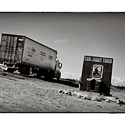 SHOT 1/31/10 2:58:37 PM - A truck passes by San Judas Tadeo capilla near Vicam Pueblo, Mexico along Highway 15. In the Roman Catholic Church he is the patron saint of desperate cases and lost causes. Roadside capillas, or tiny chapels, in the Mexican states of Nayarit, Sinaloa and Sonora. The capillas are common along the roads and highways of Mexico which is heavily Catholic and are often dedicated to certain patron saints or to the memory of a loved one that has passed away. Often times they contain prayer candles, pictures, personal artifacts or notes. (Photo by Marc Piscotty / © 2010)