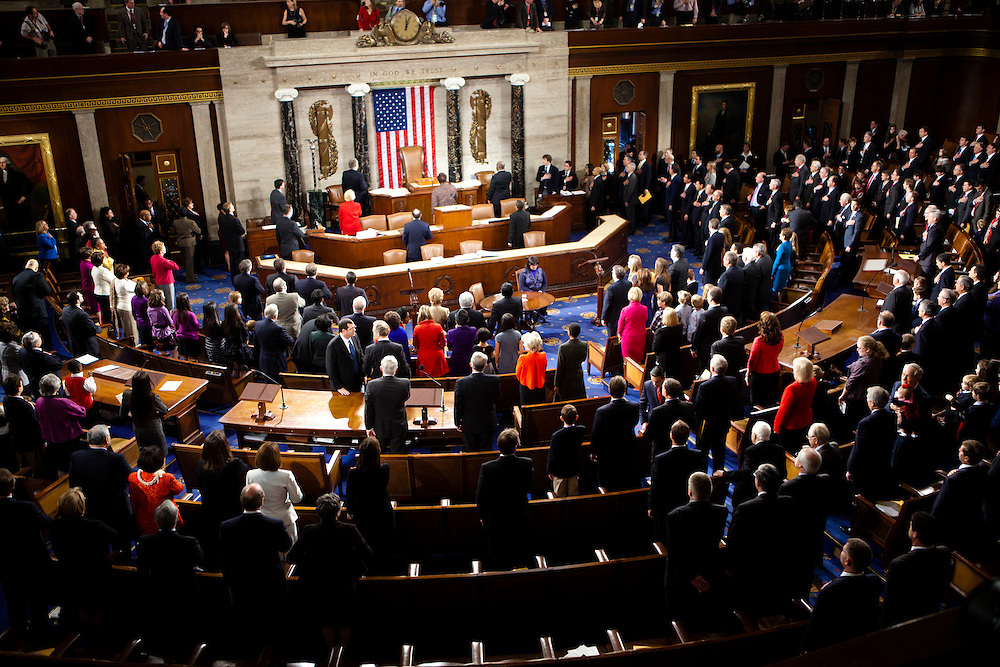 New members of Congress say the pledge of allegiance before being sworn in on Capitol Hill on Wednesday, January 5, 2011 in Washington, DC.