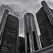 &quot;The Renaissance Center&quot; B&amp;W<br /> <br /> The beautiful architecture and design of a group of buildings on the Detroit River Front, known as The Renaissance Center, The RenCen, or The GM Renaissance Center. <br /> <br /> This group of buildings is the world headquarters for General Motors!<br /> <br /> This image is done in a dramatic black and white for those that love monochrome!!<br /> <br /> Cities and Skyscrapers by Rachel Cohen