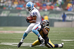 Sept 27, 2009; East Rutherford, NJ, USA; Tennessee Titans wide receiver Nate Washington (85) is tackled by New York Jets cornerback Darrelle Revis (24) during the first half at Giants Stadium.