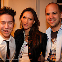 """Brian Wolk, Zani Guggelman and Claude Morais attend the opening of """"Lady"""" by Douglas Friedman at the Ruffian Gallery on April 23, 2009 in New York City."""