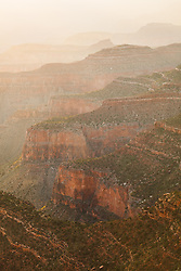 The warm light of summer begins to fill the Grand Canyon.
