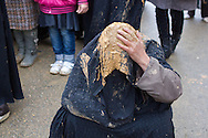 Shi'a muslim woman, covered in mud, praying on the streets of Bijar, during the Day of Ashura, on which shi'a muslims commemorate the martyrdom of Husayn ibn Ali, grandson of Muhammad, and third shi'a imam (Bijar, Iran, 2012).