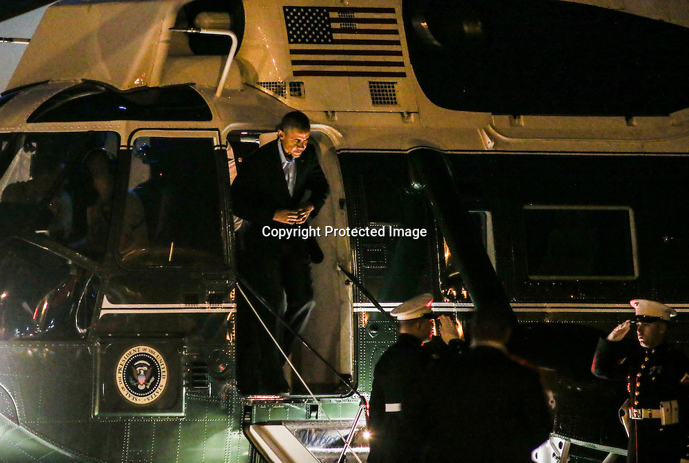 President Barak Obama exits the Marine one helicopter at Los Angeles International Airport in Los Angeles on Saturday, Oct. 10, 2015.  (AP Photo/Ringo H.W. Chiu)