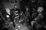 Soldeirs of the Free Syrian Army take cover as shelling from the government forces gets harder.