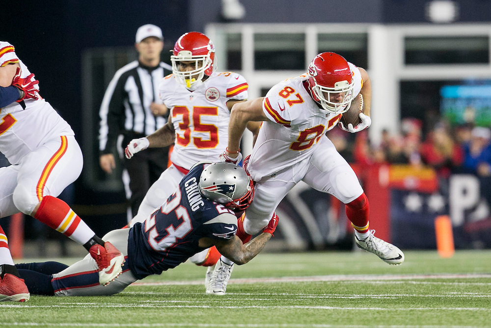 New England Patriots safety Patrick Chung (23) tackles Kansas City Chiefs tight end Travis Kelce (87) for a loss in the second quarter of the AFC Divisional Playoff game at Gillette Stadium in Foxborough, Massachusetts on January 16, 2016.     Photo by Kelvin Ma/ UPI