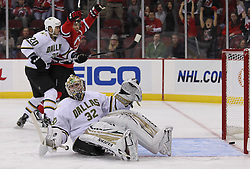 Oct 8; Newark, NJ, USA; New Jersey Devils left winger Zach Parise (9) celebrates New Jersey Devils center Travis Zajac's (19) goal on Dallas Stars goaltender Kari Lentonen (32) during the first period at the Prudential Center.