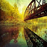 Abandoned railway bridge over river Wupper, Germany.<br /> <br /> Stillgelegte Eisenbahnbr&uuml;cke &uuml;ber die Wupper bei M&uuml;ngsten.<br /> <br /> <br /> Society6 prints &amp; more: http://society6.com/product/Bridge-over-untroubled-water_Print