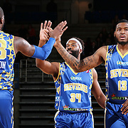 Delaware 87ers Guard BARON DAVIS (34), center, attempts to hi fives his team mate Delaware 87ers Forward RICK JACKSON (23) in the first half of a NBA D-league regular season basketball game between the Delaware 87ers and the Iowa Energy Friday, Mar. 04, 2016. at The Bob Carpenter Sports Convocation Center in Newark, DEL.