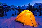 Yellow dome tent in winter, John Muir Wilderness, Sierra Nevada Mountains, California