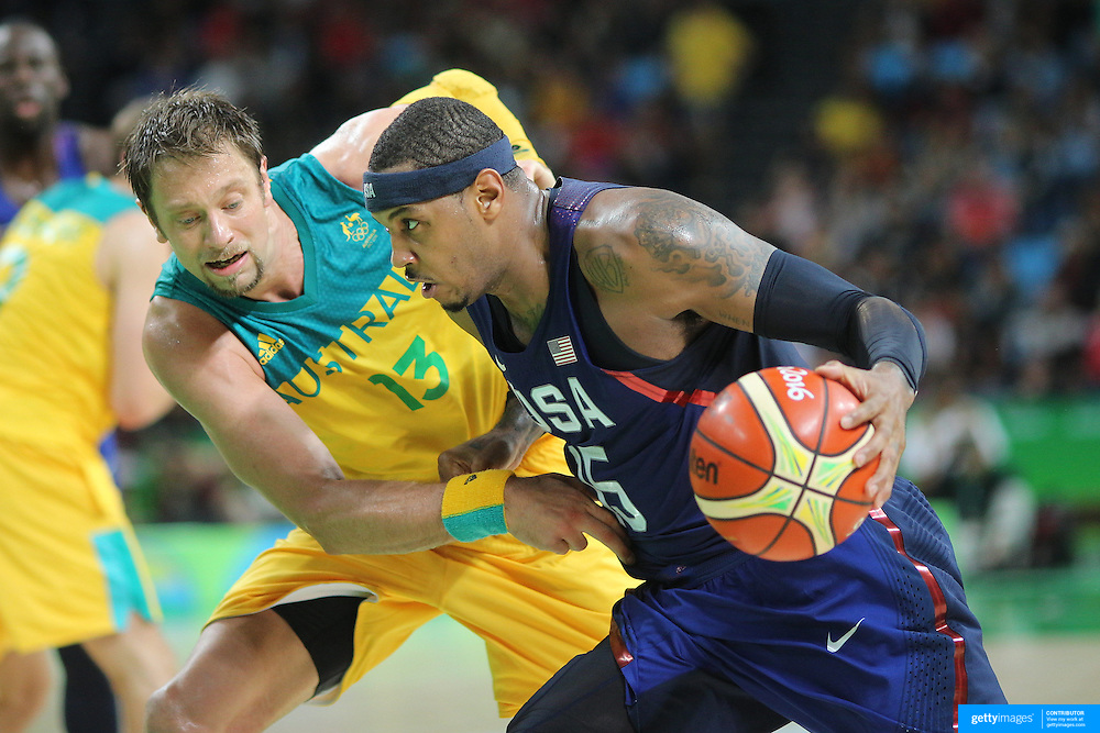 Basketball - Olympics: Day 5   Carmelo Anthony #15 of United States drives to the basket defended by David Andersen #13 of Australia during the USA Vs Australia Men's Basketball Tournament at Carioca Arena1on August 10, 2016 in Rio de Janeiro, Brazil. (Photo by Tim Clayton/Corbis via Getty Images)