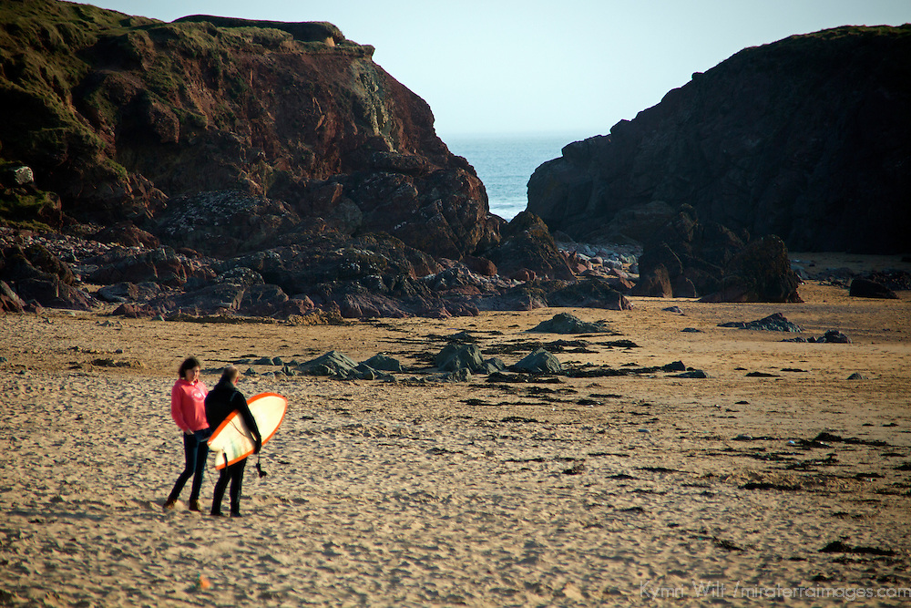 Europe, United Kingdom, Wales, Pembrokeshire. Surfers at Freshwater West Beach.