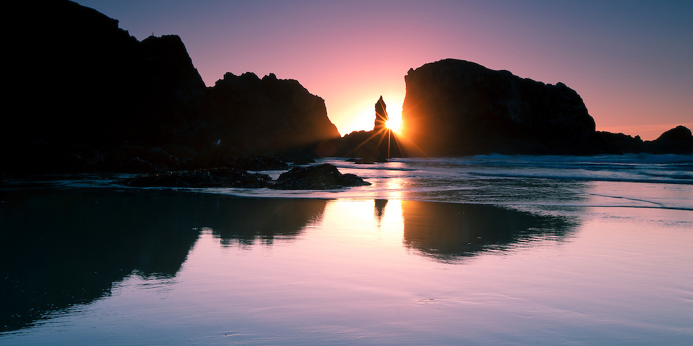 Panorama of magical colors of the sunset on the beach at Bandon, Oregon