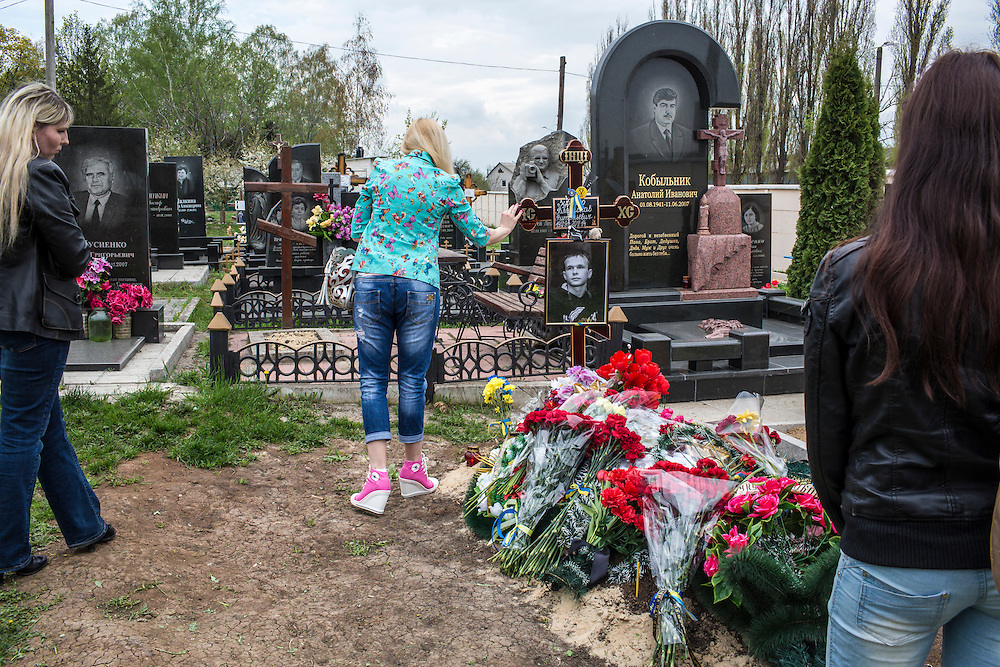 KHARKIV, UKRAINE - APRIL 22: Women visit the grave of Vladislav Zubenko, who died after being shot during the Euromaidan protests in Kiev in February, on what would have been his 23rd birthday on April 22, 2014 in Kharkiv, Ukraine. Following turbulence with the central government, pro-Russian activists have been occupying government buildings and demanding greater autonomy in many Eastern Ukrainian cities in recent weeks. (Photo by Brendan Hoffman/Getty Images) *** Local Caption ***