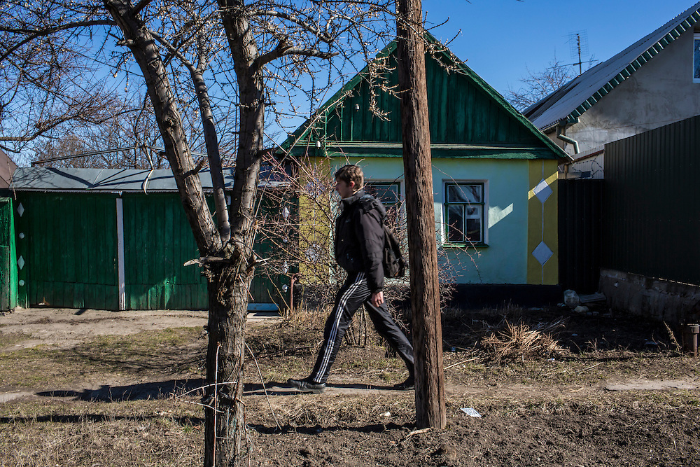 LUHANSK, UKRAINE - MARCH 16, 2015: Pavel Pavlov walks to the house where his friend Aleksandr Kryukov lives with his grandmother  in Luhansk, Ukraine. The two have created a series of popular YouTube videos involving scientific experiements. CREDIT: Brendan Hoffman for The New York Times