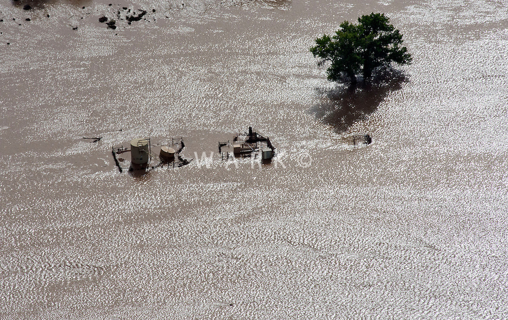 Flooding along St Vrain River in Weld County, Colorado near Platteville.  Oil well destroyed.
