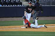 Ole Miss' Alex Yarbrough (2) is safe at third with a stolen base in front of \Austin Peay's Greg Bachman at Oxford-University Stadium in Oxford, Miss. on Wednesday, March 2, 2010.