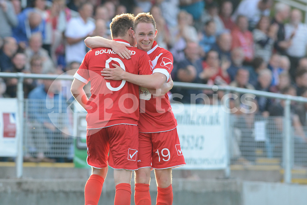 Newtown's Luke Boundford celebrates with Craig Williams   after opening the scoring during the Europa League Qualifying match between Newtown AFC and Valletta FC at Paveways Latham Park Stadium, Newtown, Powys, Wales on 2 July 2015. Photo by Garry Griffiths.