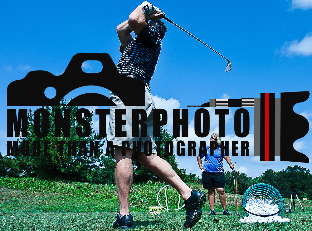 "08/06/11 Avondale PA: Delaware head football coach K.C. Keeler (Left) practices his golf swing with Inniscrone director of golf Lori Van Sickle (Right) Saturday Aug. 6, 2011 at Inniscrone Golf Course in Avondale PA...Keeler ""Said he had a great teacher and a great teaching connection with Lori Van Sickle""...The News Journal/SAQUAN STIMPSON"