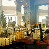 Downtown Cairo reflected in the windows of the Nile Hilton's rooftop bar.