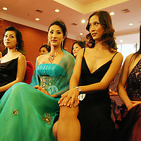 """BEIJING, 12 DECEMBER 2004: contestants, icluding Liu Xiaojing ( 3rd from L) a 22 year old transsexual,  of the """"first worldwide artificial beauty pageant """" which will be held in Beijing next week, wait during a press conference in Beijing, December 12, 2003, in China...Beauty business in China , from cosmetic surgeries to hair brush sales, has amounted to more than USD 7 billion in 2003..."""