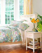 bed with floral sheets