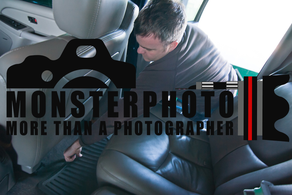 031211 Wilmington DE: 20ll.anything_carwash News Journal Reporter Justin Williams adjust floor matts in the back of a SUV Saturday morning at Prices Corner Car Wash in Wilmington Delaware...Special to The News Journal/SAQUAN STIMPSON