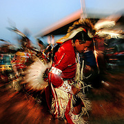 """A """"men's traditional"""" style dancer of the Oglala Sioux (Lakota) tribe enters the arena during the Saturday night """"grand entry"""" of the 20th Annual Oglala Nation Pow Wow on the Pine Ridge Reservation in Pine Ridge, SD. on Saturday, Aug. 6, 2005. The Pow Wow is a 4 day long traditional celebration of Native American and Lakota culture that draws visitors from around the world."""