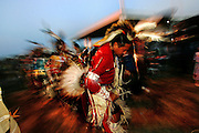 "A ""men's traditional"" style dancer of the Oglala Sioux (Lakota) tribe enters the arena during the Saturday night ""grand entry"" of the 20th Annual Oglala Nation Pow Wow on the Pine Ridge Reservation in Pine Ridge, SD. on Saturday, Aug. 6, 2005. The Pow Wow is a 4 day long traditional celebration of Native American and Lakota culture that draws visitors from around the world."