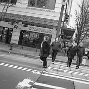 2017 MARCH 05 - Pedestrians cross 3rd Ave at Union Street downtown, Seattle, WA, USA. By Richard Walker