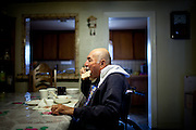 Jesus Garibaldo, who is disabled and confined to his wheelchair, eats lunch at his home in the Parklawn neighborhood of Modesto, Calif., February 22, 2012.