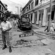 A Cuban officer blocks off a side street during the 1st of May celebrations in Havana.