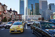 Taxies waiting for customers outside Tokyo station.