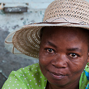 Woman at a market stall in Port Mathurin.
