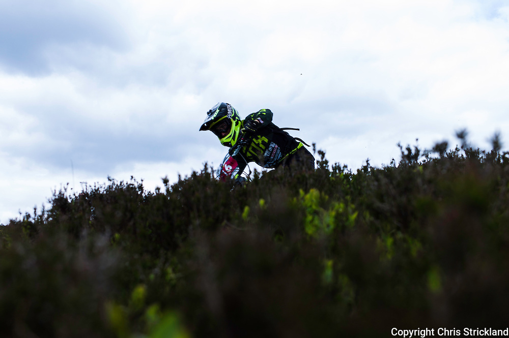 Innerleithen, Scottish Borders, 31st May 2014. Descending Minch Moor on stage 3. One of the core values of the discipline is accessibility, with amateurs competing on the same Stages as the professionals. This mix of ability and background is unique to the enduro format, allowing normal bike riders to compete against their heroes. TweedLove is now the UK's biggest bike festival, with visitors coming from all over the planet for two weeks of bike events including the first ever UK round of the Enduro World Series.