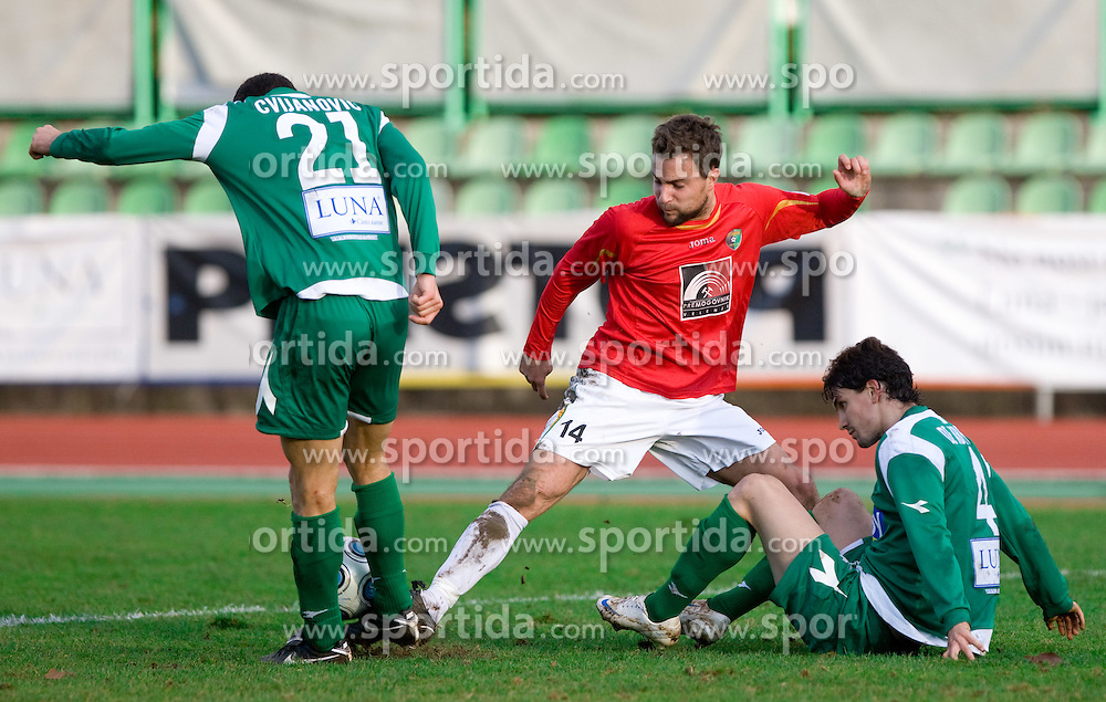 Tim Lo Duca of Rudar between Miroslav Cvijanovic of Olimpija  and  Ferreira F. De Abreu of Olimpija at  football match of 21st Round of First League between NK Olimpija and NK Rudar Velenje, on December 2, 2009,  in ZSD Ljubljana, Ljubljana, Slovenia.  Rudar defeated Olimpija 1:0. (Photo by Vid Ponikvar / Sportida)