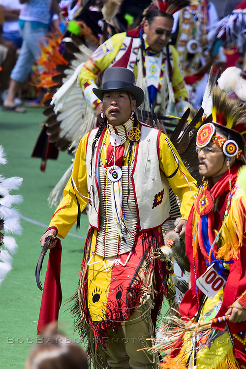 Native American male dancing at ceremonial Pow Wow at Browning , Montana