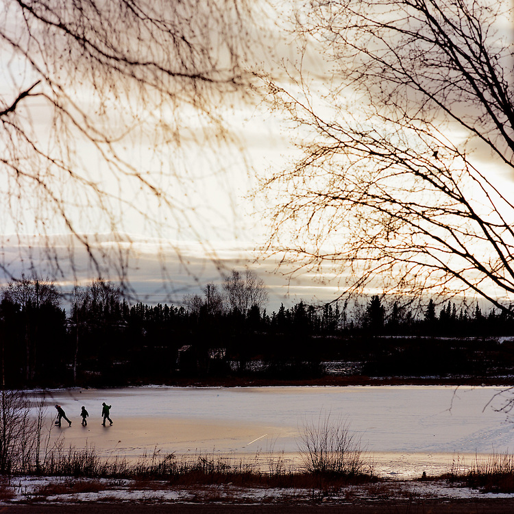 Kids playing on a pond in Shungnak, Alaska. 2015
