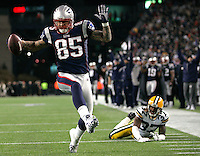 New England Patriots tight end Aaron Hernandez (85) dances into the endzone after beating Green Bay Packers cornerback Sam Shields (37) on a 10-yard touchdown reception in the fourth quarter at Gillette Stadium in Foxboro, Massachusetts on December 19, 2010.  The Patriots defeated the Packers 31-27.   UPI/Matthew Healey