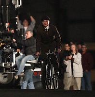February 08th 2011 Los Angeles, CA. ***EXCLUSIVE*** <br /> Leo DiCaprio in character as a young J. Edgar Hoover films a scene for &quot;J Edgar&quot;. In this scene, DiCaprio walks out of the Hoover family home and rides a bicycle down the street as Director Clint Eastwood is seen watching in the background. The scene was filmed in a historic home and neighborhood in Los Angeles. <br /> Photo by Eric Ford / On Location News 818-613-3955 info@onlocationnews.com