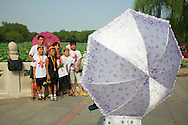 Families taking pictures in Behai park in Beijing, China.