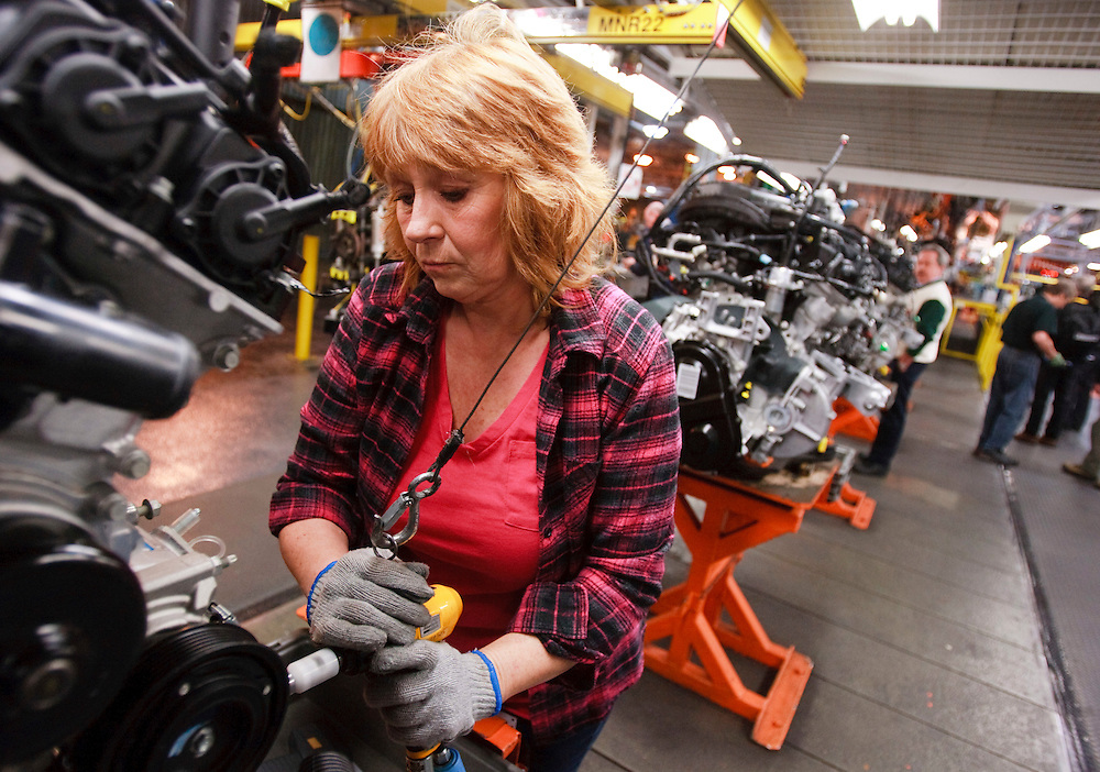 Debbie Carder works on an engine on the production line at Chrysler's Minivan Assembly plant in Windsor, Ontario as the company celebrated the production launch of the new Dodge Grand Caravan and Chrysler Town and Country, January 18, 2011.<br /> The Canadian Press/GEOFF ROBINS