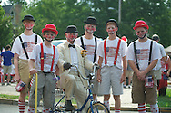 John Arrechea and his grandsons in the 4th of July parade in Oxford, Miss. on Thursday, July 4, 2013.