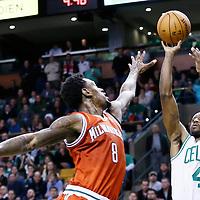 21 December 2012: Boston Celtics shooting guard Jason Terry (4) takes a jumpshot over Milwaukee Bucks center Larry Sanders (8) during the Milwaukee Bucks 99-94 overtime victory over the Boston Celtics at the TD Garden, Boston, Massachusetts, USA.
