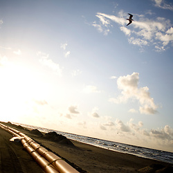 Orange barriers are seen, put in place to prevent oil from further contaminating the beach on June 23, 2010 in Grand Isle, LA where oil has reached the shore. The Deepwater Horizon and the British Petroleum oil spill has been claimed as the most damaging environmental disaster in history.