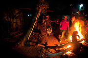 Dominican Republic: Andre, a 48 yearl old Mayi or Magician performs a ritual around the fire at the compound of Bleo, a Vodú  priest and head of El GaGá de San Luis on the outskirts of Santo Domingo.
