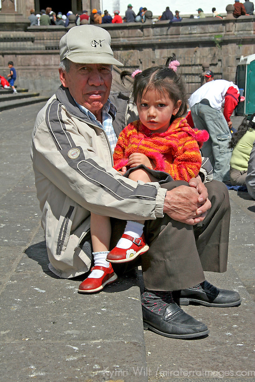 South America, Ecuador, Quito. Ecuadorian man and his granddaughter enjoy Quito's public plaza.